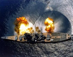 The battleship  firing a salvo to starboard